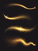 Sparkle stardust. Golden glittering magic vector waves with gold particles collection. Golden sparkle glitter, illustration of shiny stardust trail