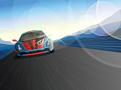 Speeding Race Car, coming forward on road/ race track.  Background with mountains & sky.  Lens Flare & Motion Blur added.