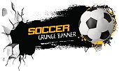 Sport vector grunge banner with soccer ball flying from cracked earth. White background