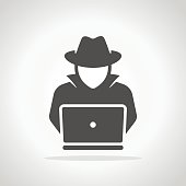 Spy agent searching on laptop. Hacker