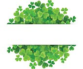 St. Patrick's day vector background with green shamrock.