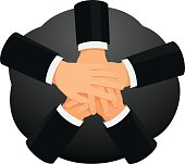 Business people are stacking hands in a huddle. Teamwork and partnership.