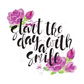 Start the day with a smile - motivational quote, typography art. Hand-written lettering on a white background with roses. Lettering for posters, cards design.