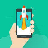 Startup vector concept, flat cartoon style quick rocket launch and mobile phone or smartphone in hand, idea of successful business project start up, boost technology, innovation strategy