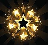 Explosion of golden, sparkling stars on a black background. Golden Star.