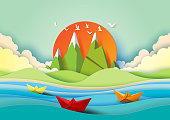 Summer concept with island, beach and colorful paper boats sailing on the sea.Paper art style vector illustration.