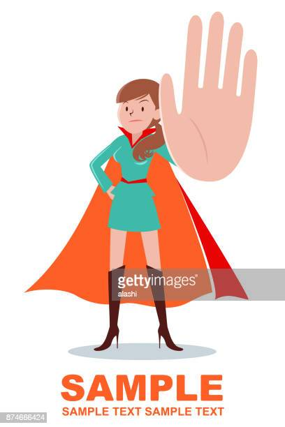 Super heroines (young woman with brown hair ponytail) gesturing stop hand sign and standing with hand on hip