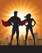 Man and woman superhero silhouette.