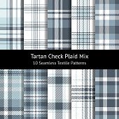 Tartan pattern set. Seamless check plaid in grey, blue, and white for flannel shirt, poncho, scarf, and other modern fashion textile design. Herringbone, pixel, woven, and hounds tooth stripe texture.