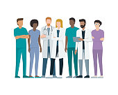 Multiethnic team of doctor and nurses standing together, healthcare and medicine concept