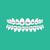 Teeth with braces on the green background. Vector illustration