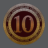 Tenth happy anniversary celebration symbol. Golden maroon medal emblem in vintage style.