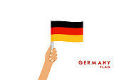 The hand holding the flag of Germany. White background vector work