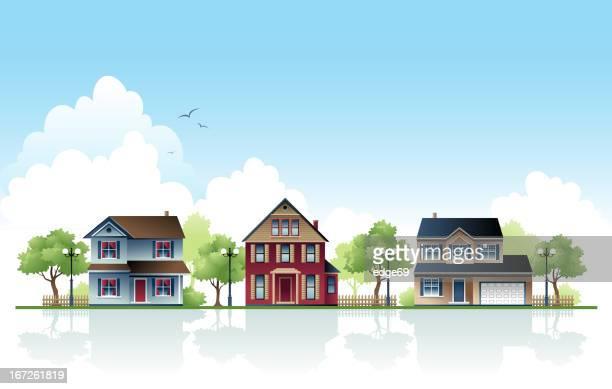 Tres casas en una zona suburbana durante el día