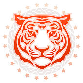 Circular tattoo illustration in red, orange, gray and peach of the   front view of a tiger's head surrounded by a decorative frame and stars   on a white background