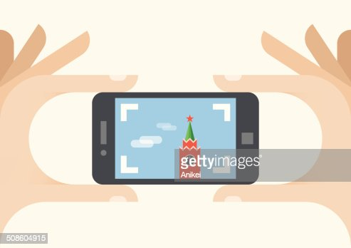Tourist with mobile phone camera. Photo of Moscow Kremlin, Russia : Vector Art