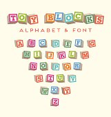 Toy baby blocks font alphabet for lettering designs. 3-dimensional blocks in bright colors.