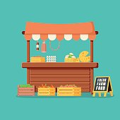 Traditional wooden market food stall full of groceries products with flags, crates and chalk board. Vector illustration in flat style