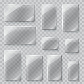Set of transparent glass plates of different shapes in gray colors. Transparency only in vector file. Vector illustrations. EPS10, JPG and AI10 are available