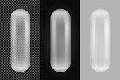 Transparent oval plastic capsule.