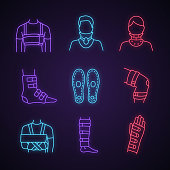 Trauma treatment neon light icons set. Rib belt, cervical collar, ankle and knee braces, insoles, shoulder immobilizer, shin support, wrist brace. Glowing signs