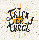 "Halloween background. ""Trick or treat"" lettering. Hand drawn vector illustration."