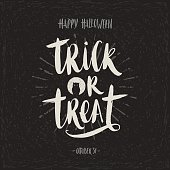 Trick or treat - hand drawn calligraphy. Halloween vector illustration. Holiday poster, invitation or greeting card.