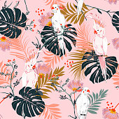 Tropical floral print. Parrot bird in the jungle and flowers in the exotic forest  allover design, seamless pattern vector for fashion ,wallpaoer and all prints on pink background color
