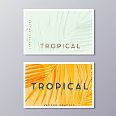 Tropical florals and foliage, botanical, bohemian business card templates. Minimalist wedding postcard design. Palm leaves decoration.