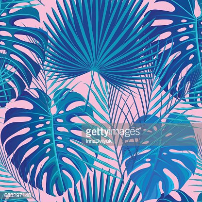 Tropical seamless pattern with exotic palm leaves. : stock vector