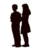 Two children playing, silhouette vector