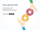 Two hands holding gears together. Teamwork, partnership, business, cooperation and management concept.