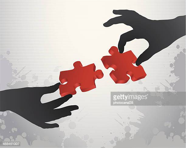Two hands holding puzzle pieces to form a solution