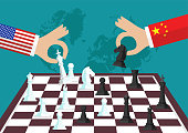 Two people playing chess. Conflict between USA and China