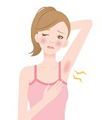 a woman removes her underarm hair and has skin troubles with red bumps.