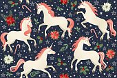 Unicorns on a Christmas floral background Seamless pattern.