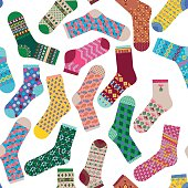 Various multi-colored socks. Seamless background pattern. Vector illustration