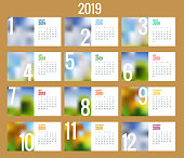 Vector Calendar for 2019 year. Vector design print template with place for photo. Set of 12 calendar pages. Stationery design.