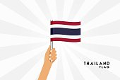 Vector cartoon illustration of human hands hold Thailand flag. Isolated object on white background.