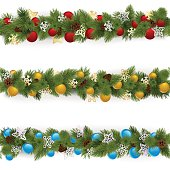Vector set of Christmas borders decorated with golden, blue and red baubles, isolated on white background
