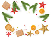christmas holiday festive table new year poster banner template with space for text. Spruce tree branches, orange slices, cookies, present boxes origami stars and confetti Vector isolated illustration