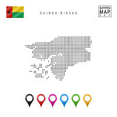 Dotted Map of Guinea-Bissau. Simple Silhouette of Guinea-Bissau. The National Flag of Guinea-Bissau. Set of Multicolored Map Markers. Vector Illustration Isolated on White Background.