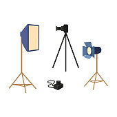 vector flat cartoon professional photo equipment set. Lens dslr photo camera standing at special tripod stand, softbox, searchlight. Isolated illustration on a white background.