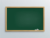 Vector green school chalkboard with chalk pieces.