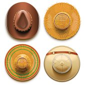 Vector set of four hats top view, including cowboy, safari, straw and sombrero hat, isolated on white background