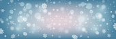 Many white cold flake elements on blue background, bokeh, defocused lights. White snowflakes flying in the air.  Vector heavy snowfall, snowflakes in different shapes and forms.