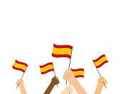 Vector illustration hands holding Spain flags isolated on white background