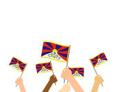 Vector illustration hands holding Tibet flags isolated on white background