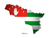Vector illustration with abkhazian national flag with shape of Abkhazia map (simplified). Volume shadow on the map.
