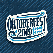 Vector label for Oktoberfest, cut paper sign with rhombus ornament, decorative swirls and original brush lettering for words oktoberfest 2019 on blue abstract background.